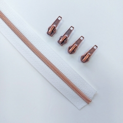 endlos Reißverschluss metallisiert KUPFER 6,5 mm Spirale + 3 Schieber, weiß