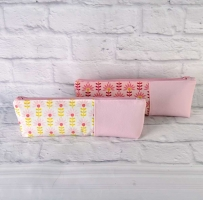 Baumwollstoff Blumen beschichtet, rosa ockergelb weiß