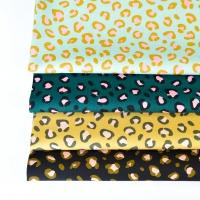 Baumwollstoff Leopardenmuster, schwarz rosa petrol