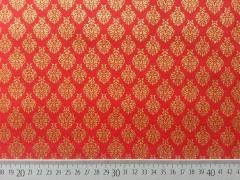 RESTSTÜCK 20 cm Baumwollstoff Weihnachtsornamente, gülden auf rot