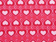 Herzen rosa auf rot