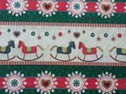 Baumwollstoff Weihnachtsbordüre Schaukelpferd, grün cremeweiß